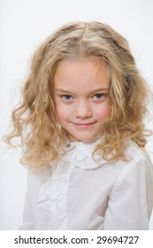 Portrait of the attractive little girl on a white background