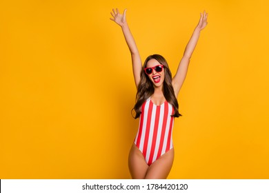 Portrait of  attractive lovable stunning cheerful slim lady rising hands up having fun weekend isolated on bright vivid shine vibrant yellow color background
