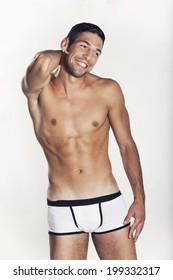 Portrait of a attractive macho man wearing underwear