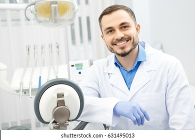 Portrait of an attractive male dentist sitting at his office copyspace profession occupation doctor medicine clinic help experience trustworthy specialist care health vitality dentistry dental oral