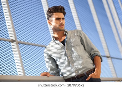 portrait of attractive man dressed casual, looking cool and very appealing