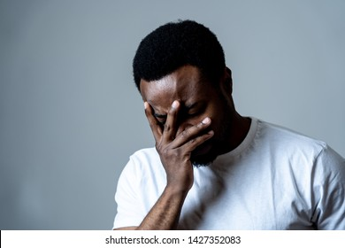 Portrait of attractive man sad and depressed suffering depression feeling sorrow and unpleasant pain in human emotions facial expressions and depression concept. Isolated on grey blue background.