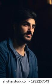Portrait of an attractive man wearing a blue shirt.