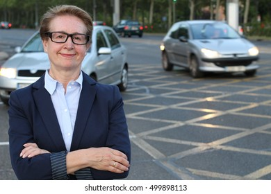 Portrait of attractive mature businesswoman with her arms crossed in the city
