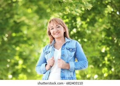 Portrait of attractive mature woman in beautiful park