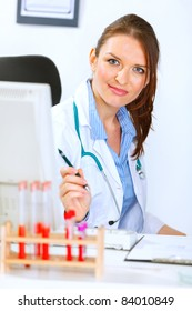 Portrait of attractive medical doctor woman sitting in office