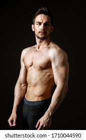 Portrait of an attractive muscular man on a dark background