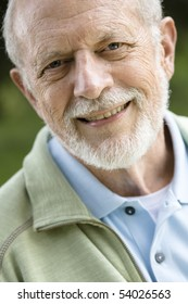 Portrait of an Attractive Old Man With a Beard Smiling Directly to the Camera