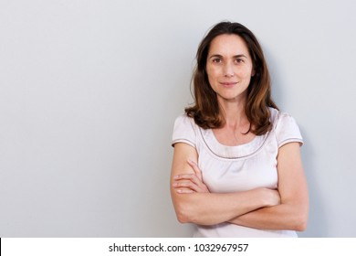 Portrait of attractive older woman against white wall