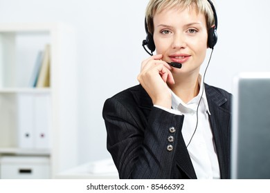 Portrait of attractive receptionist with headset