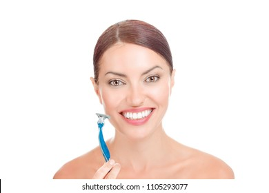Portrait attractive relaxed smiling happy woman holding her shaving razor about to shave her face, isolated on white background. Mixed race latin american caucasian model. Positive face expression