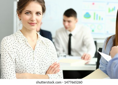 Portrait of attractive secretary sitting in big modern building and discussing important business project or new start-up. Company meeting concept. Blurred background