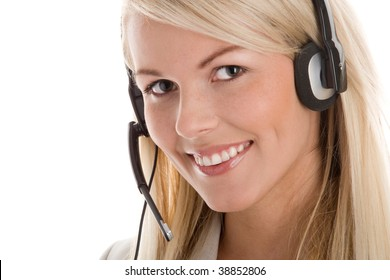 Portrait of attractive secretary/telephone operator wearing headset isolated on white background