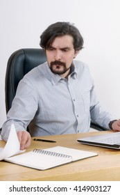 portrait of attractive serious man working at his desk at the office; business concept
