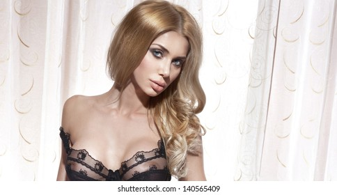 Portrait of attractive sexy blonde lady looking at camera.