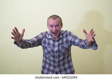 Portrait of attractive smile young man raised up arms hands at you.
