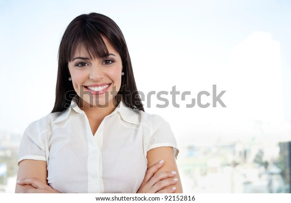 Portrait of attractive smiling businesswoman with arms crossed