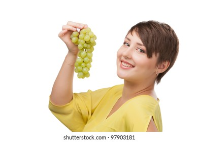 portrait of attractive smiling girl isolated on white studio shot with grapes