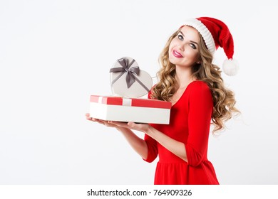 Portrait of attractive smiling woman blond in santa's hat and red dress isolated on white. Concept of the New Year and Christmas holiday.