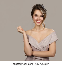 Portrait of attractive smiling woman in evening dress. Gray background.