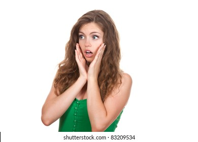 portrait of attractive surprised excited scared, terrified teenage girl wear green shirt, with brown long hair, isolated over white background concept of worried student, young pretty woman