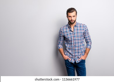 Portrait of attractive tempting masculine mature self-assured stunning fashionable modern stylish guy wearing blue checkered shirt jeans keeping hands in pockets isolated on gray background copy-space