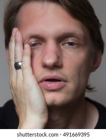 Portrait of a attractive tired russian guy