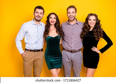 Portrait of attractive two fancy ladies macho guys four members company students graduation party photo set well-dressed cheerful best friends hugging isolated yellow color background