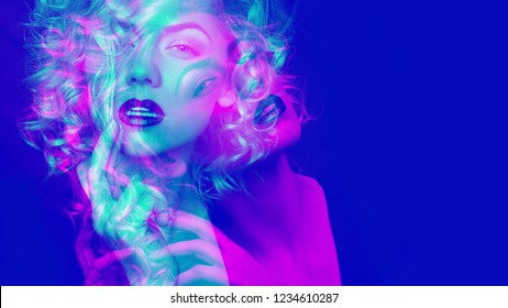Portrait of a attractive woman with blonde curly hair. Double color exposure.