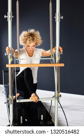 Portrait of attractive woman doing exercises at the gym.Pilates  concept
