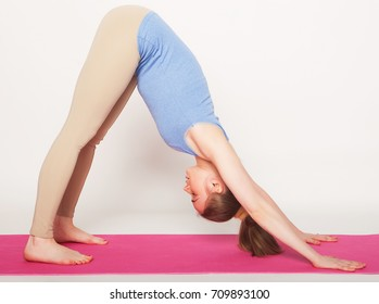 Portrait of attractive woman doing yoga, pilates. Healthy lifestyle and sports concept.