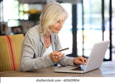 Portrait of attractive woman with laptop computer and credit card