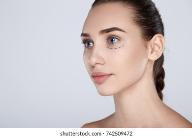 Portrait of attractive woman with plastic surgery at studio