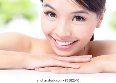 portrait of attractive woman smile with green background , model is a asian beauty