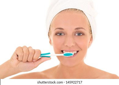 portrait of attractive woman in towel with toothbrush isolated over white background