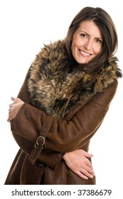 Portrait of attractive woman wearing sheepskin smiling isolated on white background