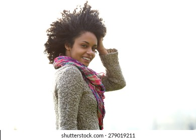 Portrait of an attractive young african american woman with hand in hair