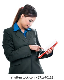 Portrait of an attractive young Asian businesswoman using tablet over white background