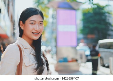 Portrait Attractive Young Asian Woman in the city.