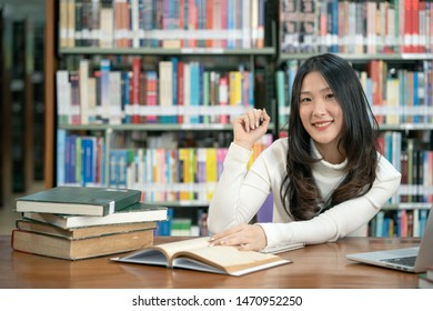 Portrait attractive young Asian woman in the library room,female people lifestyle and education concept
