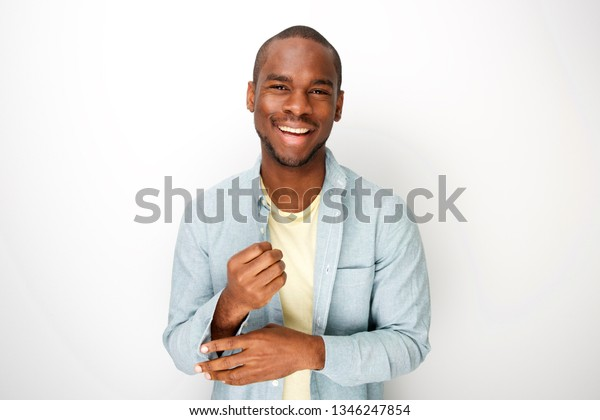 Portrait of attractive young black man smiling with shirt by white background