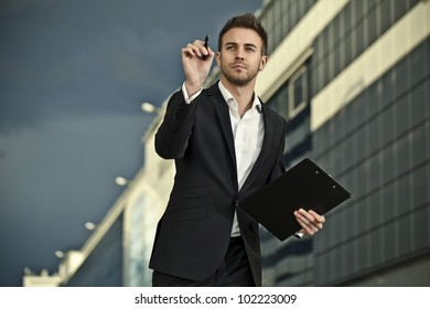Portrait of an attractive young business man concentrated.