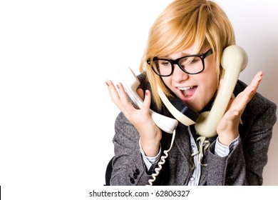 portrait of attractive young businesswoman with three phones on white background