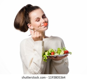 portrait of attractive young caucasian smiling woman isolated on white studio shot eating salat