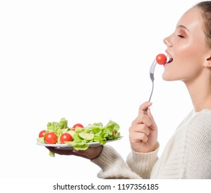 portrait of attractive young caucasian woman isolated on white studio shot eating salat