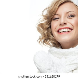 portrait of attractive young caucasian woman  toothy smile  face skin care in warm clothing  studio  shot isolated on white smiling winter