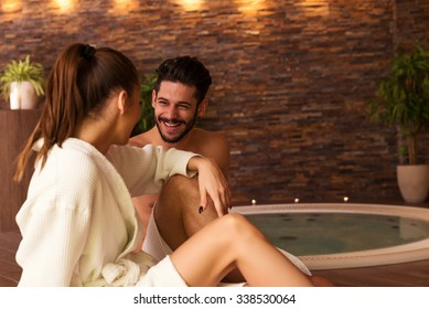 Portrait of an attractive young couple relaxing in a jacuzzi.