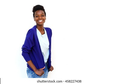 Portrait of attractive young female fashion model posing against white background with copy space