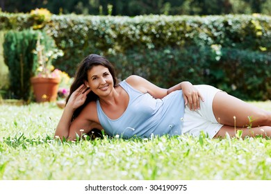 Portrait of an attractive young female lying in the grass