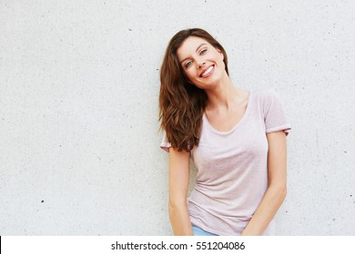 Portrait of attractive young lady smiling against white background